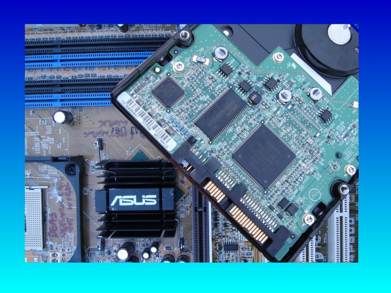 A close up picture of Asus Motherboard and sata raid hard drive. The raid 0 was lost and so the drive was not recognised as part of the array. Following this it ws sent for data recovery to ourselves.