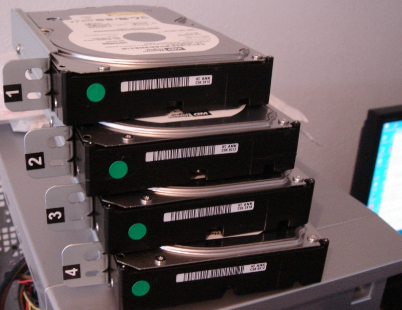 The image shows the 4 hard disk drives taken out of a DriveStation Quattro for data recovery after one disk went faulty and the raid array card configuration was lost.