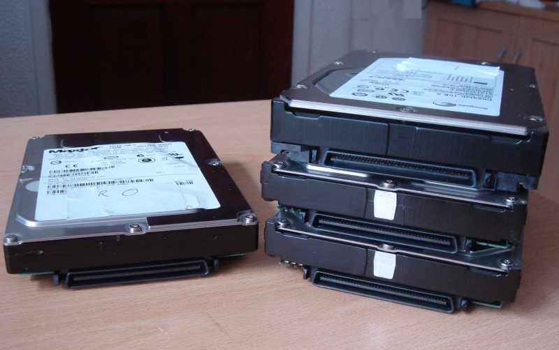 4 SCSI hard drives taken from a Dell PowerEdge 2850 that arrived at our office for recovery following corruption from a faulty raid controller. The Dell PERC had been running in degraded mode for some time before final failure of the hard disks.