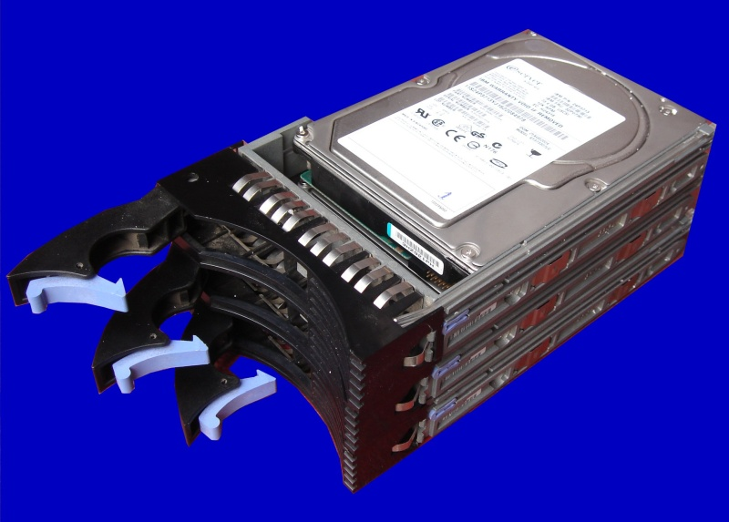 3 scsi hard drives shown in a stack. The hard disks were from an IBM e-Server x-Series which showed that 2 disks has crashed and were offline. The data in raid array was recovered and sent back to Egypt.