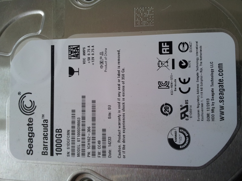A close up photo of a Seagate ST1000DM003 received by ourselves for recovery of important files. The image shows the label of the drive with capacity 1000GB.
