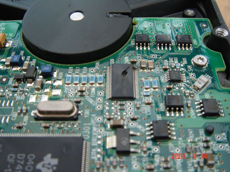 The circuit board is shown being repaired from a Maxtor external hdd which had the wrong power supply put into it and there was no response from the disk.
