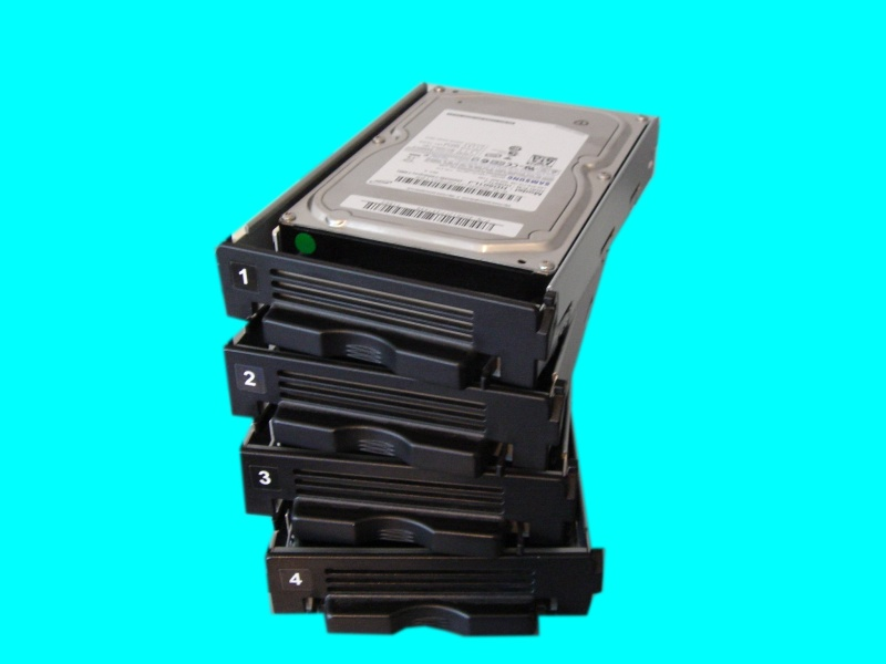 The hard drives from a Terastation that failed after a power cut. The image shows the 4 hard drives that were in a raid array when the nas box went offline.