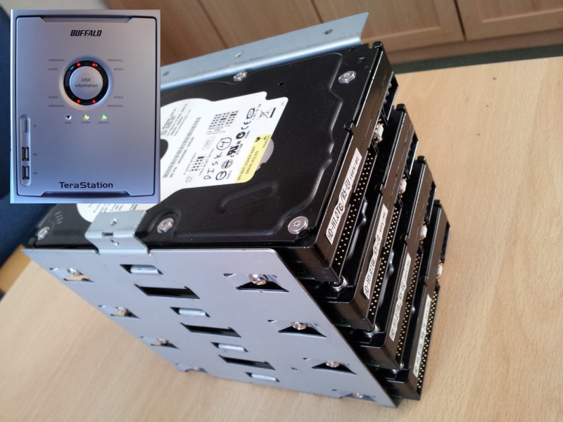 The photo shows the 4 ide hard drive by Western Digital taken from a terastation that had suffered an error in it's raid array. Also shown is the front view of a Buffalo Terastation model HD-H1.0TGL/R5 with its 4 red leds.