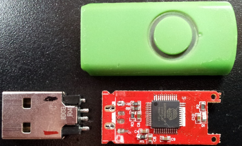 USB stick with fractured connector. The USB drive had 3 of 4 contacts which had fractured off the circuit board. Green Swivel design with single epoxy enclosed memory chip and Alcor AU6989SNHL-G-8 controller chip.