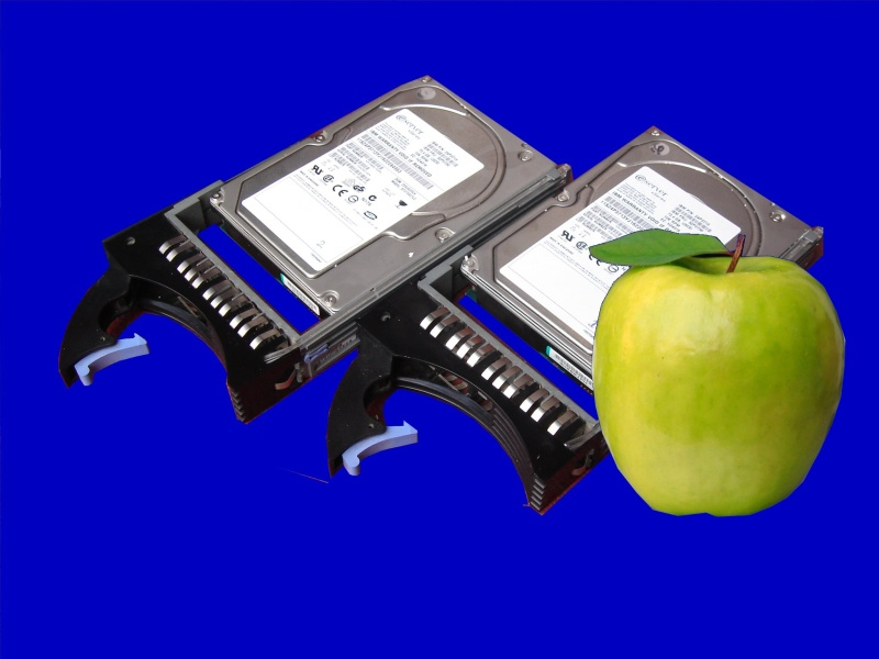 Some raid hard disks from Mac OSX X Server pictured with an Apple.