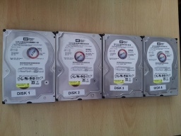 4 off 250gb SATA hard disks taken from an Acer Altos Easystore NAS that no longer had LAN network access. The disks were labelled 1 to 4 and made by Western Digital model Caviar SE WD2500JS. The disks are shwon lined up side by side.