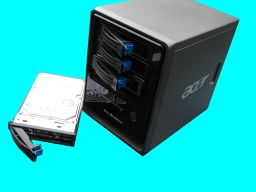 An Acer Altos Easystore is shown with one of the hard disk drives withdrawn from the NAS box. This unit had gone offline from the network overnight following a power cut and had lost the raid configuration for the 4 hdd.