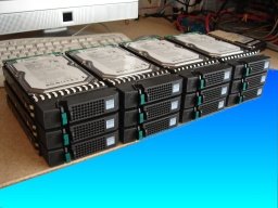 A set of 12 SAS hard disk drives that were removed from a Fujitsu Fibrecat after the raid5 array failed. The raid had restarted but some drives in Left-over state. Someone had foolishly tried to use the Trust command to start the raid, but fortunately they stopped it and sent the disks to us for data recovery.